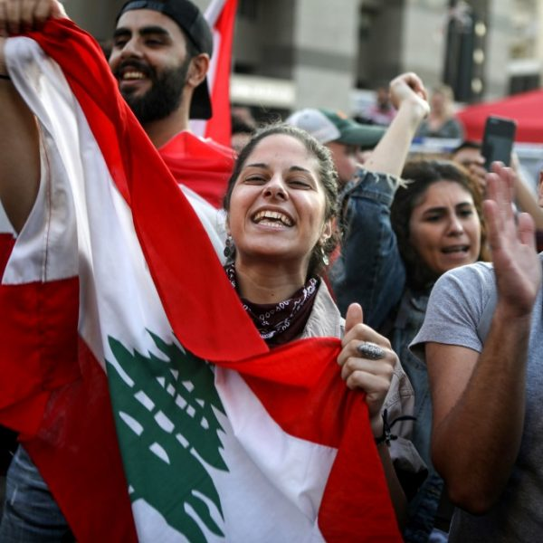 Lebanese anti-government protesters celebrate the resignation of Prime Minister Saad Hariri in Beirut on October 29, 2019 on the 13th day of anti-government protests. (Photo by Patrick BAZ / AFP)
