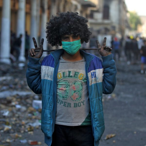 An Iraqi protester flashes the victory sign on al-Rasheed street in the capital Baghdad, during a lull in the anti-government demonstrations, on December 5, 2019. - The protest movement is Iraq's biggest since the US-led invasion of 2003 toppled Saddam Hussein and installed a democratic system in the oil-rich but poverty-plagued nation. Tens of thousands have vented their anger at a governing class they despise as inept, corrupt and beholden to foreign powers, especially neighbouring Iran, whose consulate in the city of Najaf was torched on November 27, 2019. The holy city has been a flashpoint since protesters torched the consulate, accusing Iraq's eastern neighbour of propping up a corrupt government in Baghdad. (Photo by AHMAD AL-RUBAYE / AFP)