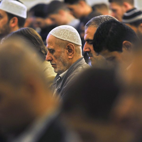 Muslims perform the Eid-ul-fitr salat, or Eid prayer at the Omar mosque in Berlin's Mashari Islamic Centre September 10, 2010. Eid marks the end of Ramadan, the Islamic holy month of fasting, for Muslims around the world.    AFP PHOTO / JOHN MACDOUGALL / AFP PHOTO / JOHN MACDOUGALL