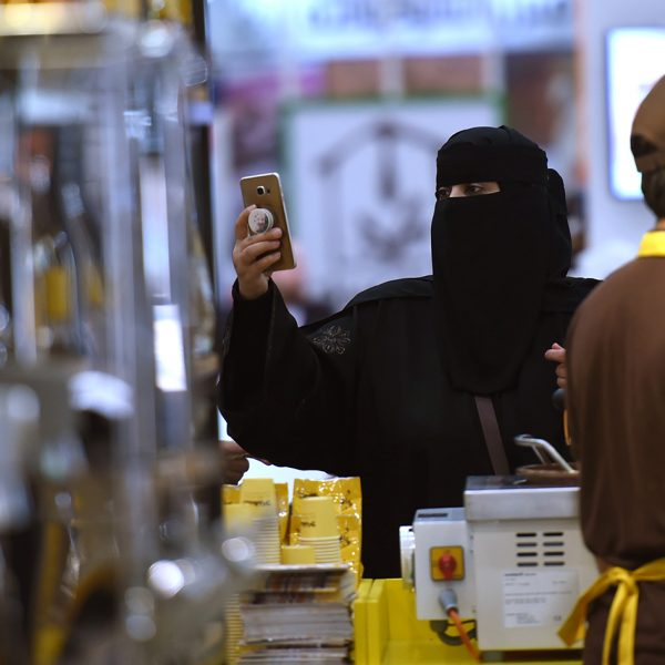 A Saudi woman uses her cell phone to take pictures of the International Coffee and Chocolate Exhibition held at the Riyadh International Convention and Exhibition Center (RICEC) in the capital Riyadh on December 4, 2017. The Exhibition is a four day event being held from 3rd December to the 6th December which successfully integrates all aspects of coffee and chocolate related industry under one roof and features the best equipment, services and products from regional and international producers and suppliers. / AFP PHOTO / FAYEZ NURELDINE