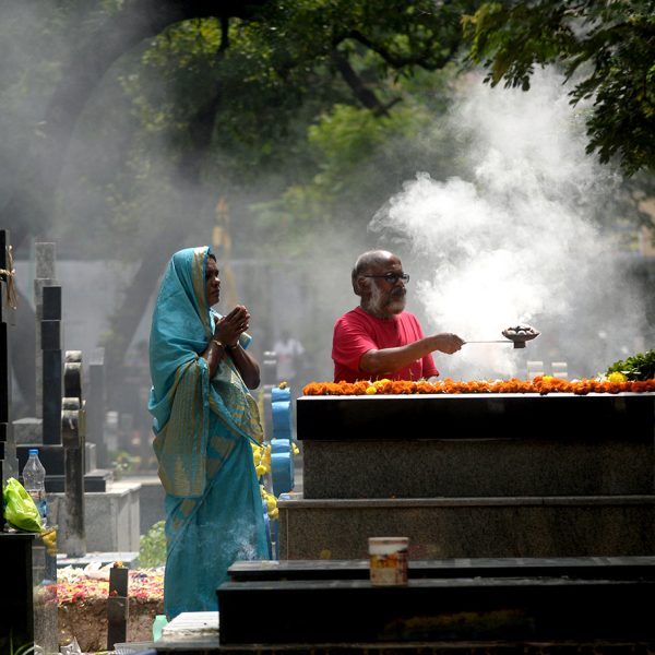 Indian Catholic devotees pay their respects at the grave of a relative during All Souls Day in Chennai on November 2, 2017. All Souls Day is observed in remembrance of friends and loved ones who have passed away -- the living pray on behalf of Christians who are in purgatory, the state in the after life where souls are purified before proceeding to heaven / AFP PHOTO / ARUN SANKAR